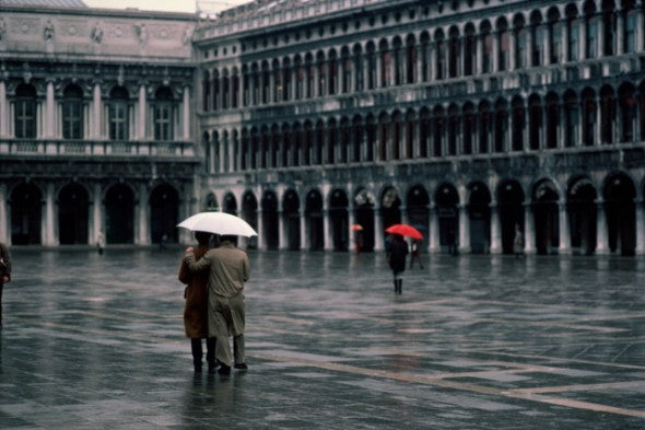 Couple walking in the rain, Piazza San Marco, Venice, Italy