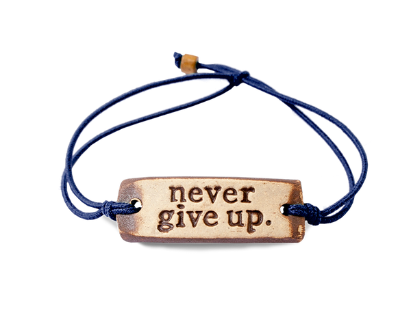MudLOVE never give up. Wrist Band