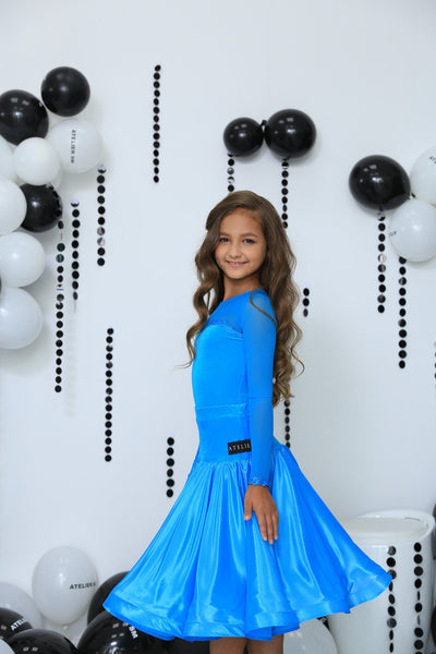 Juvenile Ballroom Dress created by Atelier SM in Turquoise.  This dress is available in most colours.  Just drop me a line with your selections.    Atelier SM Juvenile Dresses  Stunning, quality Girls Juvenile Ballroom & Latin DanceSport Dresses