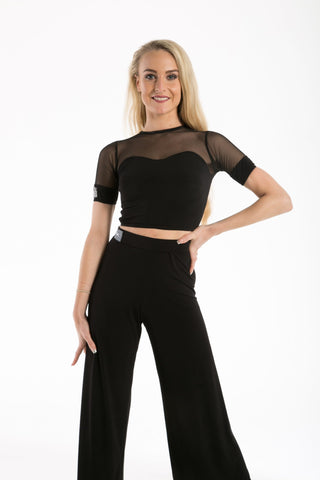 A dance top with great versatility to compliment all the skirts, leggings and trousers throughout our ranges.  Comfortable and smart this top features a key hole back with fastener and is available from small child Size 2 through to Adult size 7.  Matching skirts, wraps and trousers run across the range for Children through to Ladies.