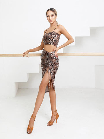 Free Australia-wide Shipping - safe & secure with tracking.  Personal Service.  Complete Zym Dance Style Range Available.  Best Price Guaranteed.  An essential latin skirt with a ruched left leg twist.  Featuring soft and stretchy fabric with an adjustable side in a short length.  Perfect for training paired with a gorgeous body or top.