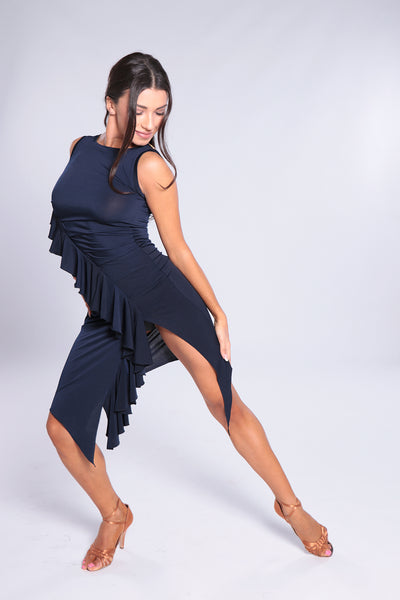 Stylish and elegant Latin Dress for all occasions.  Narrow cut latin dress with ruffles.  This slimming dress design with plenty of stretch is perfect for dance practice, social dancing, evening wear and performance.  Soft falling jersey crepe with elastane.  94% polyester - 6% elastane.