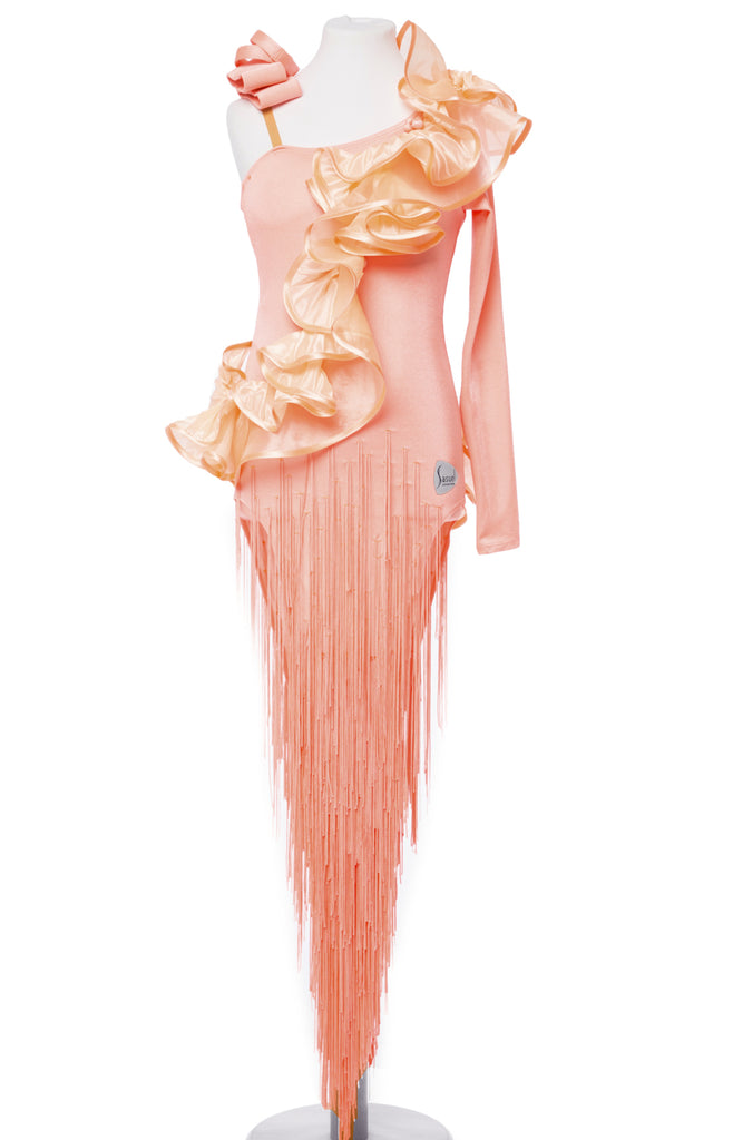 Fancy Coral-Peach coloured Junior Latin Dress made with quality Lycra, Pleated Pearl Chiffon Frills - single sleeve and bare back for a perfect Latin Look.  The skirt is decorated with long fringes.  All bracelets included.    This stunning, fully completed, ready to wear Junior & Youth Latin DanceSport Competition Dress can be created in any colour and size.