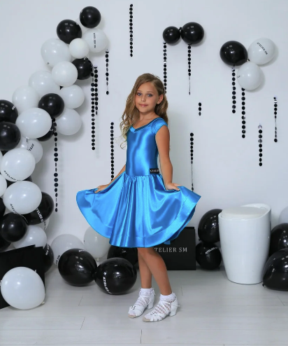 Basic Juvenile Ballroom & Latin Dress created by Atelier SM in Blue Zircon.  This dress is available in most colours.  Just drop me a line with your selections.  Fabric:  Astella.  Atelier SM Juvenile Dresses  Stunning, quality Girls Juvenile Ballroom & Latin DanceSport Dresses
