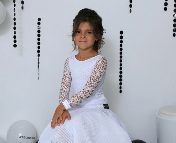Juvenile Ballroom & Latin Dress created by Atelier SM in White.  This dress is available in most colours.  Just drop me a line with your selections.  Fabric:  Chrisanne-Clover.  Atelier SM Juvenile Dresses  Stunning, quality Girls Juvenile Ballroom & Latin DanceSport Dresses