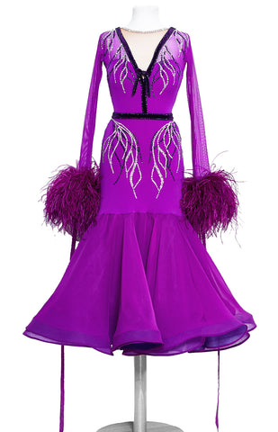 Hot magenta junior ballroom dress, with crystallized leaf pattern, in Swarovski AB and Purple crystals.  Lycra, stretch net and georgette fabrics paired with ostrich feather cuffs and georgette ribbons. The skirt is 3/4 length, perfect for tall and petite dancers as well.