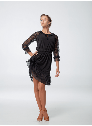 An elegant and feminine dress with 3/4 lace sleeves and ruffled lace hemline perfect for practice, performance or evening wear.