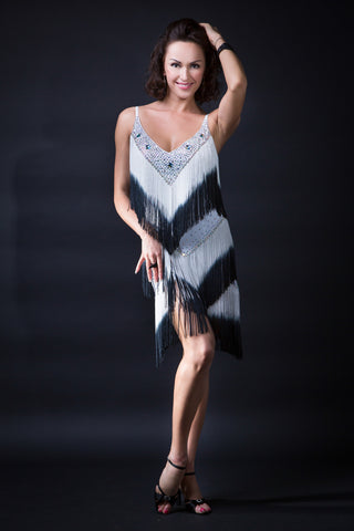 stunning latin dance dress with cross over back and long fringe in black and white gradient with swarovski crystals from dancewear for you australia