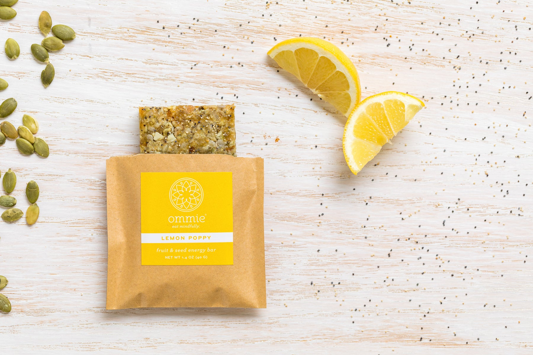 Lemon Poppy Ommie Snacks fruit & seed energy bar. Delicious. Allergy friendly. Vegan.