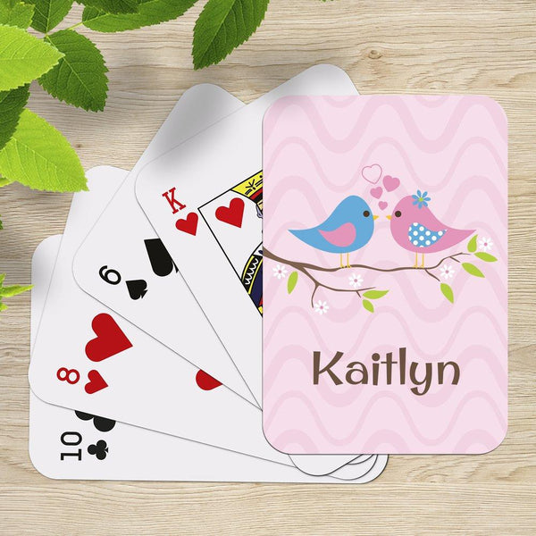 Two Birds Playing Cards