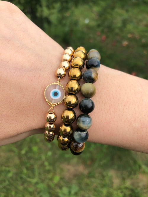 Evil eye bracelet, gold evil eye bracelet, hematite bracelet and tiger eye gemstone bracelet