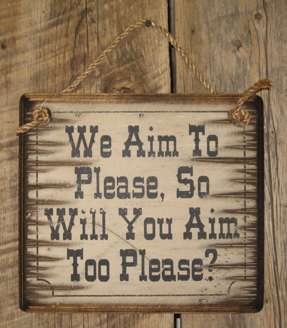 We Aim To Please, So Will You Aim Too Please  Wooden Sign
