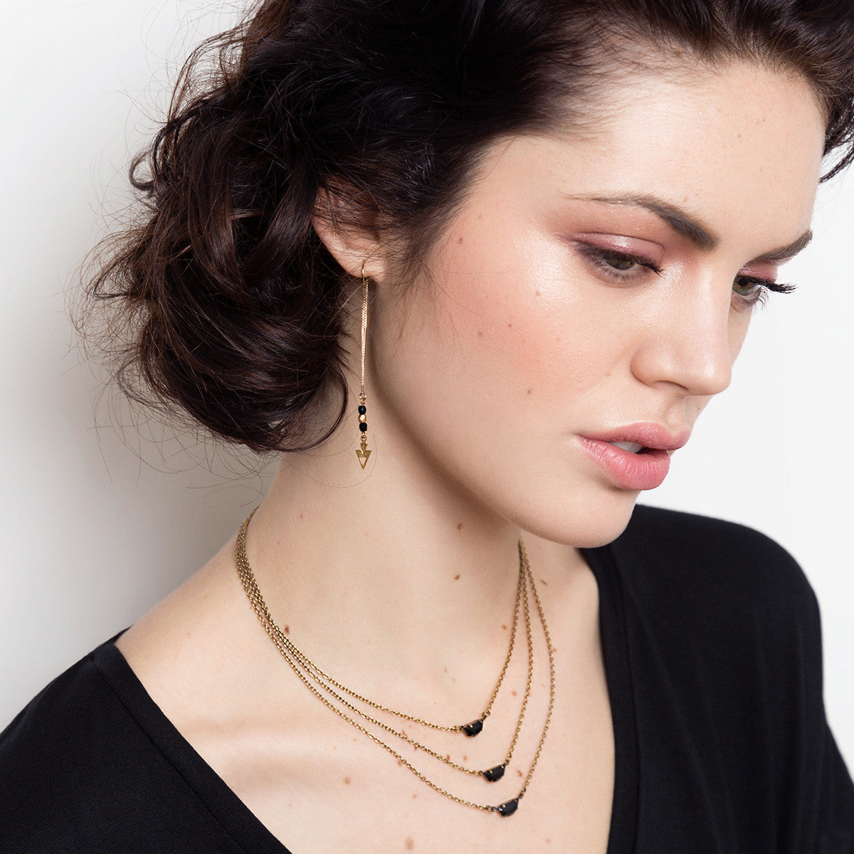 Multi layers necklace and threader earrings on model