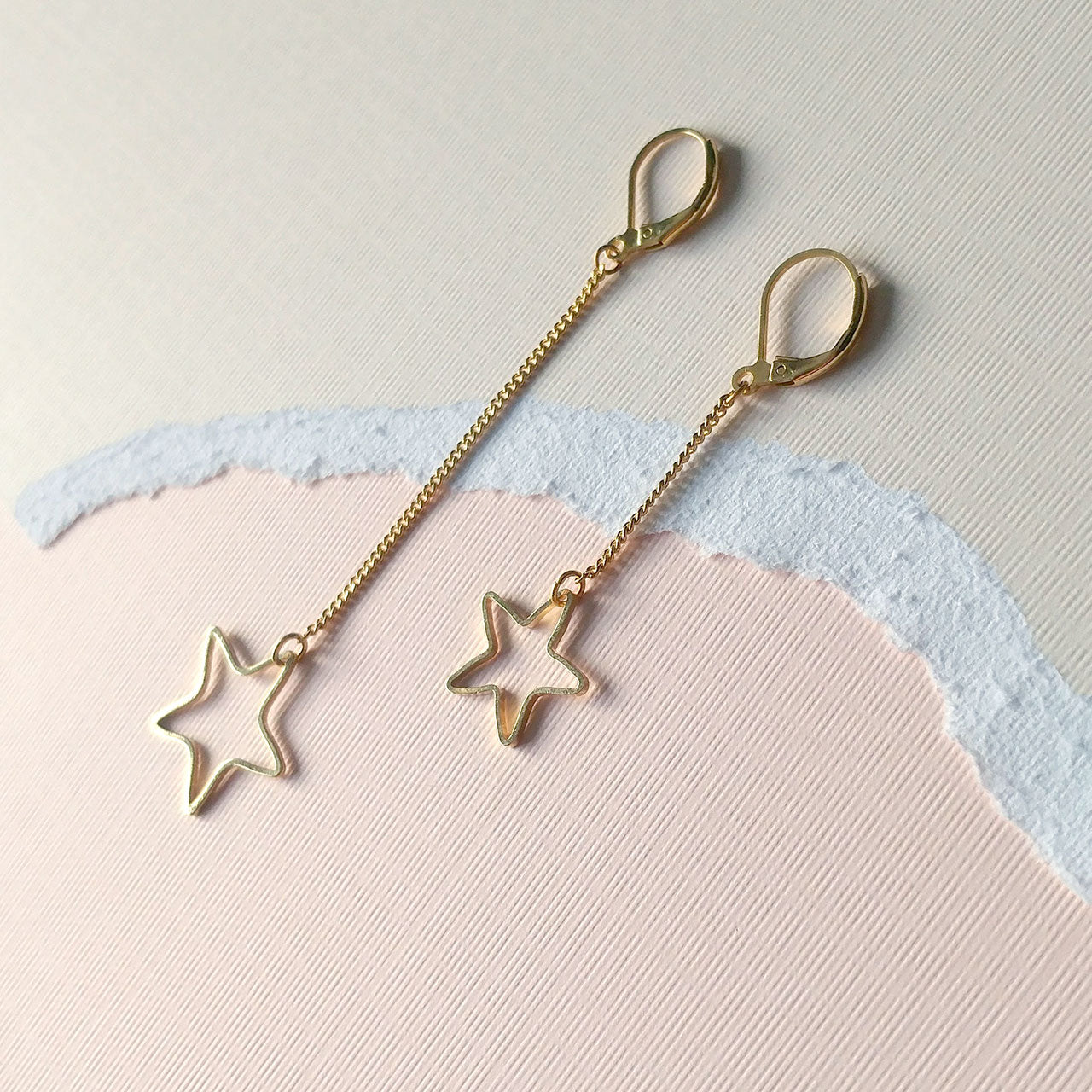 Mismatched earrings stars