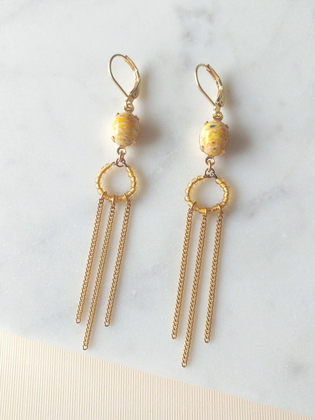 yellow earrings with tassels