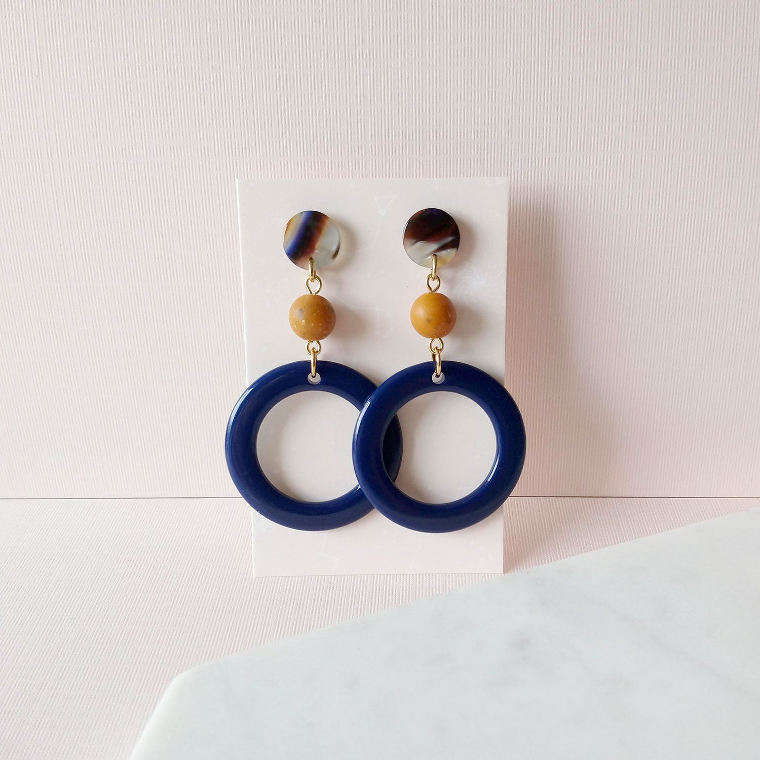 navy blue hoops earrings mustard