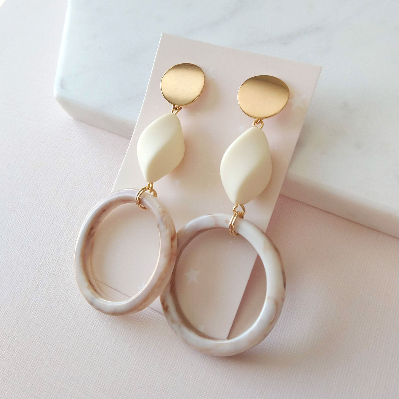 acrylic hoops earrings in beige cream and golden tones