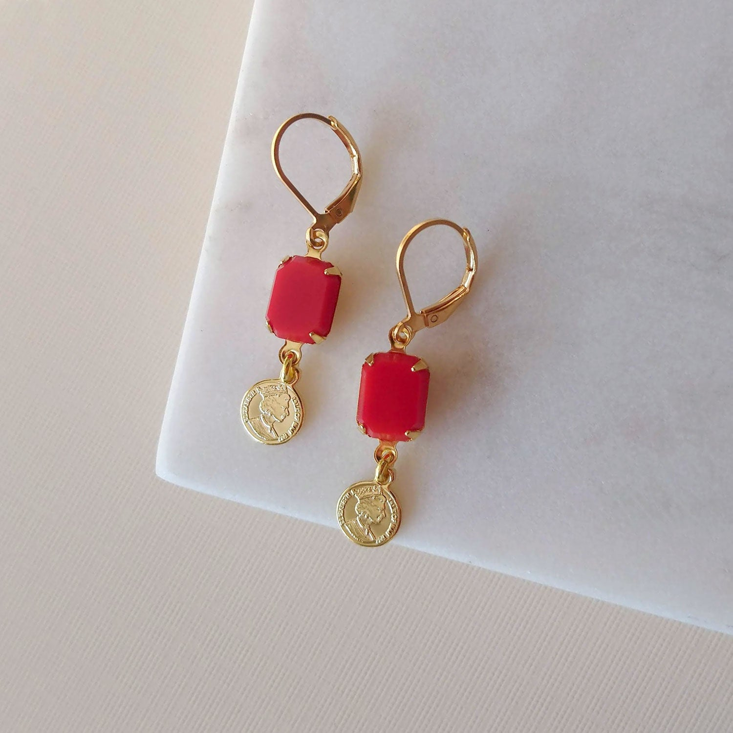 red earrings gold charm