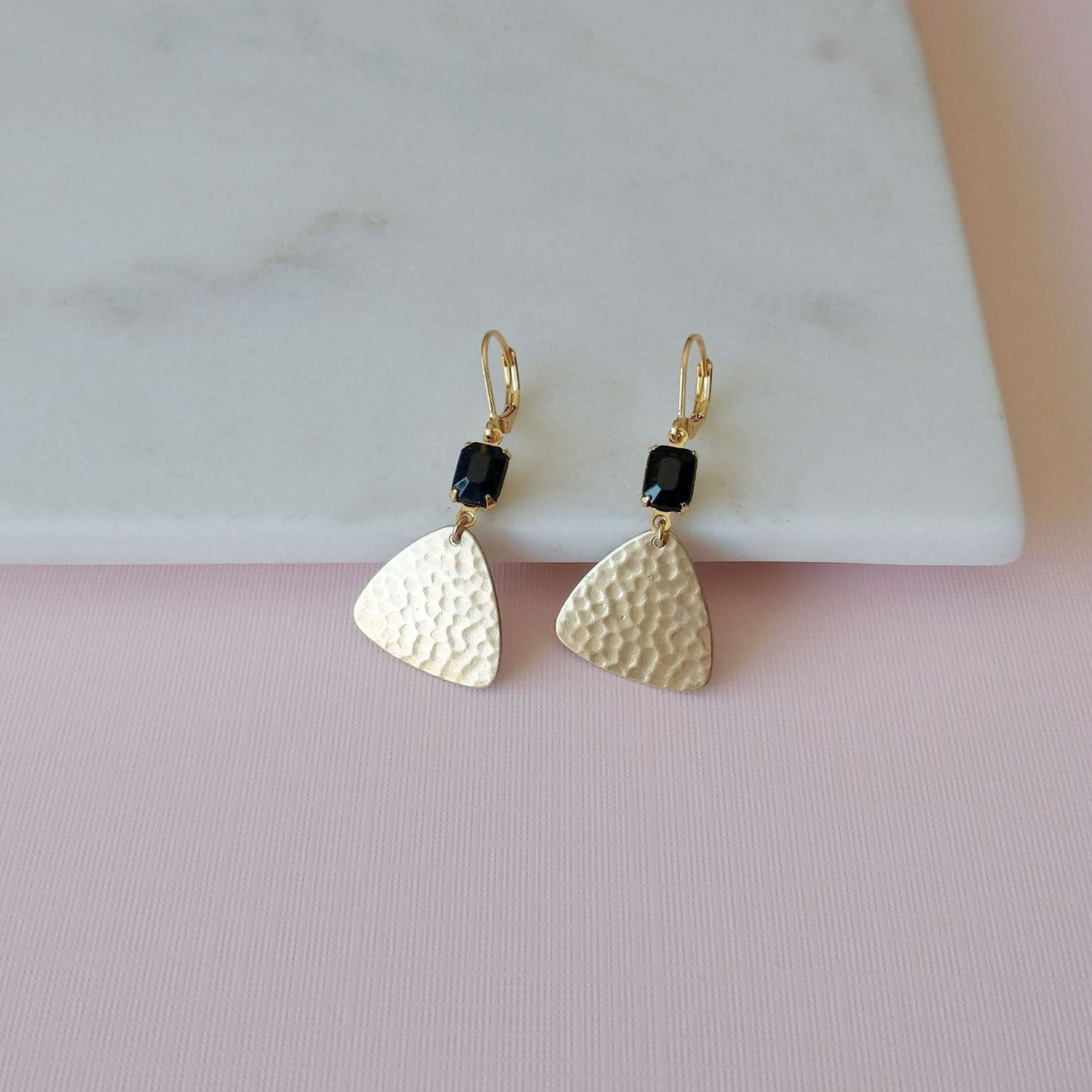 Golden fan earrings with black stones