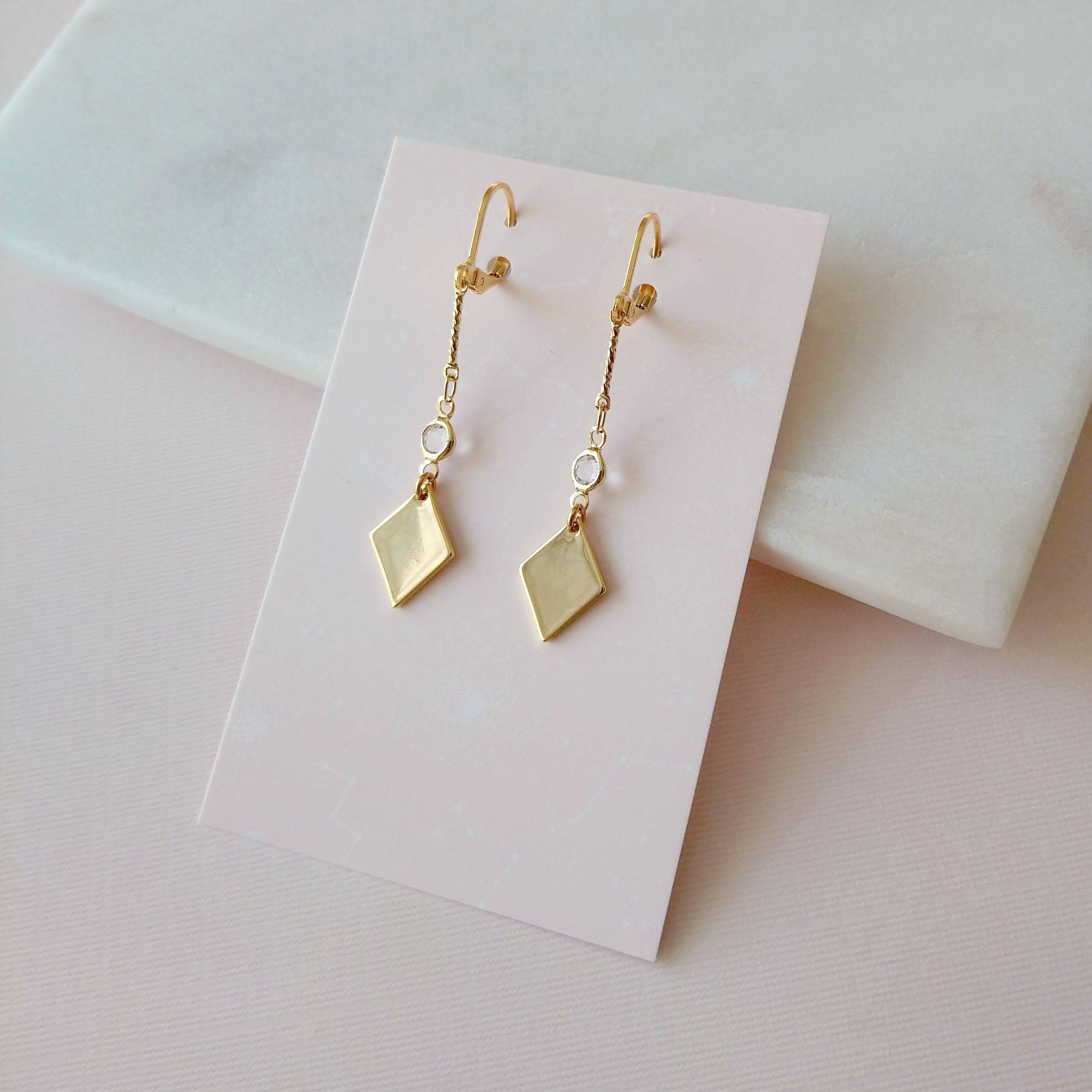 Gold and crystal earrings diamond shape
