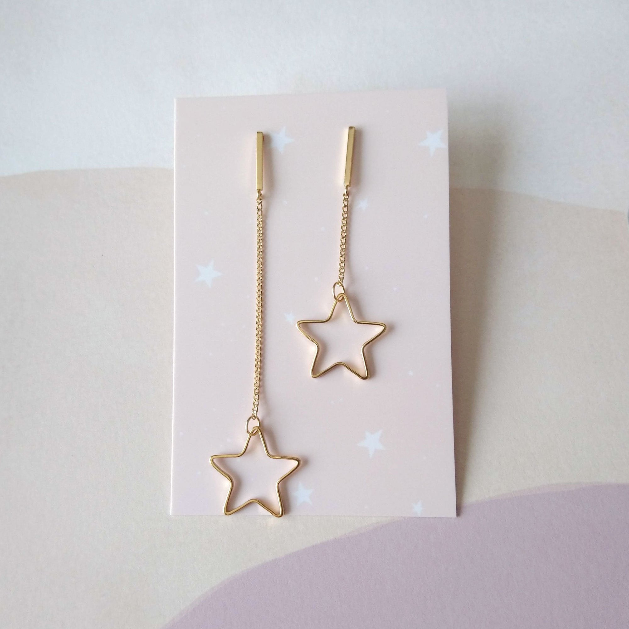 asymmetrical earrings gold stars