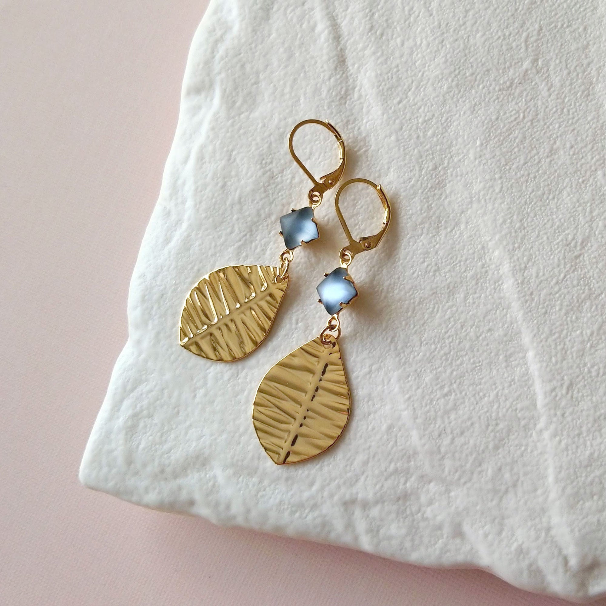 Gold plated leaves earrings with frosted grey stones