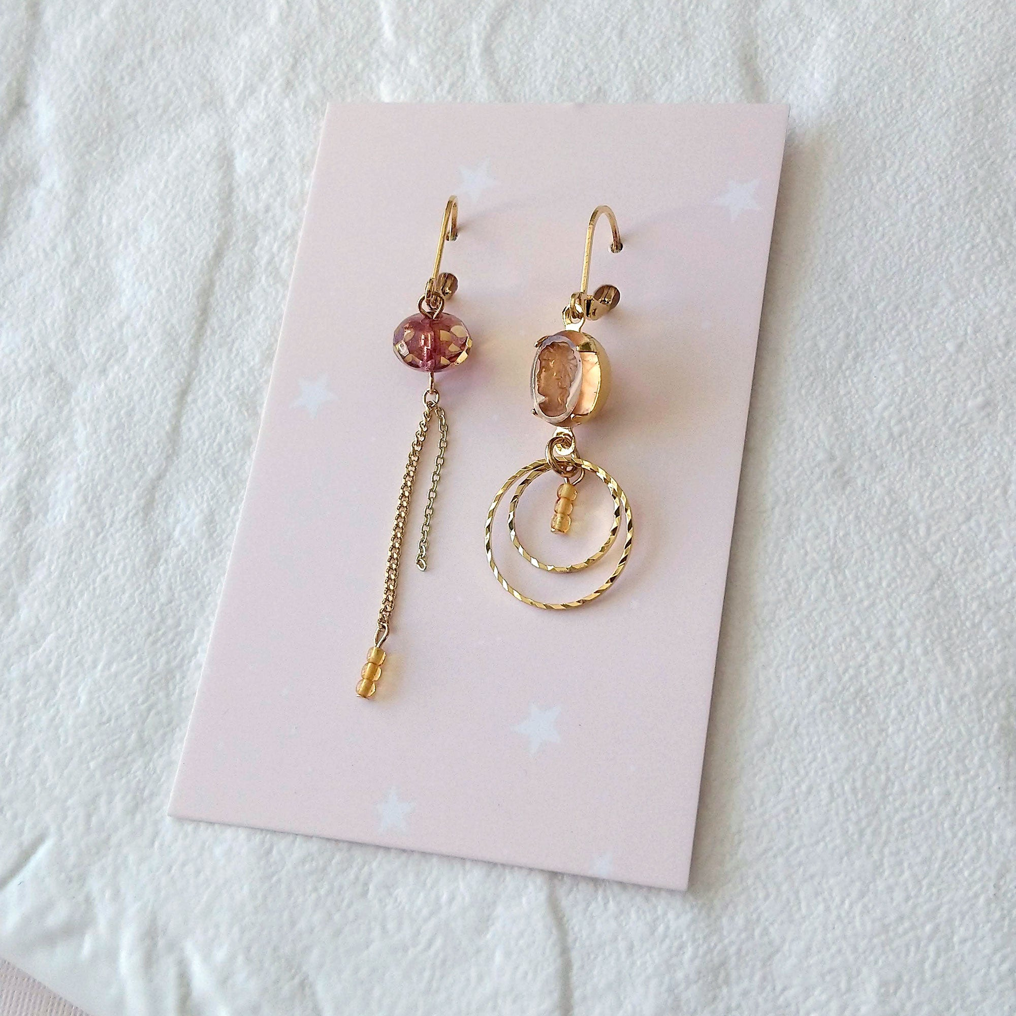 asymmetrical earrings cameo