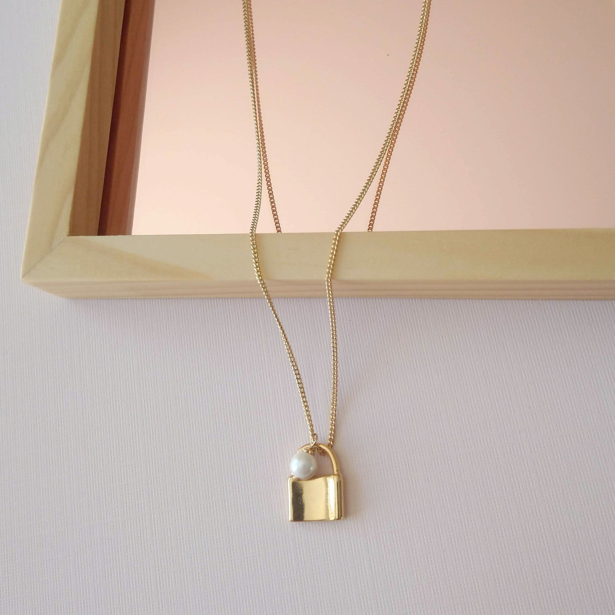gold padlock necklace with pearl