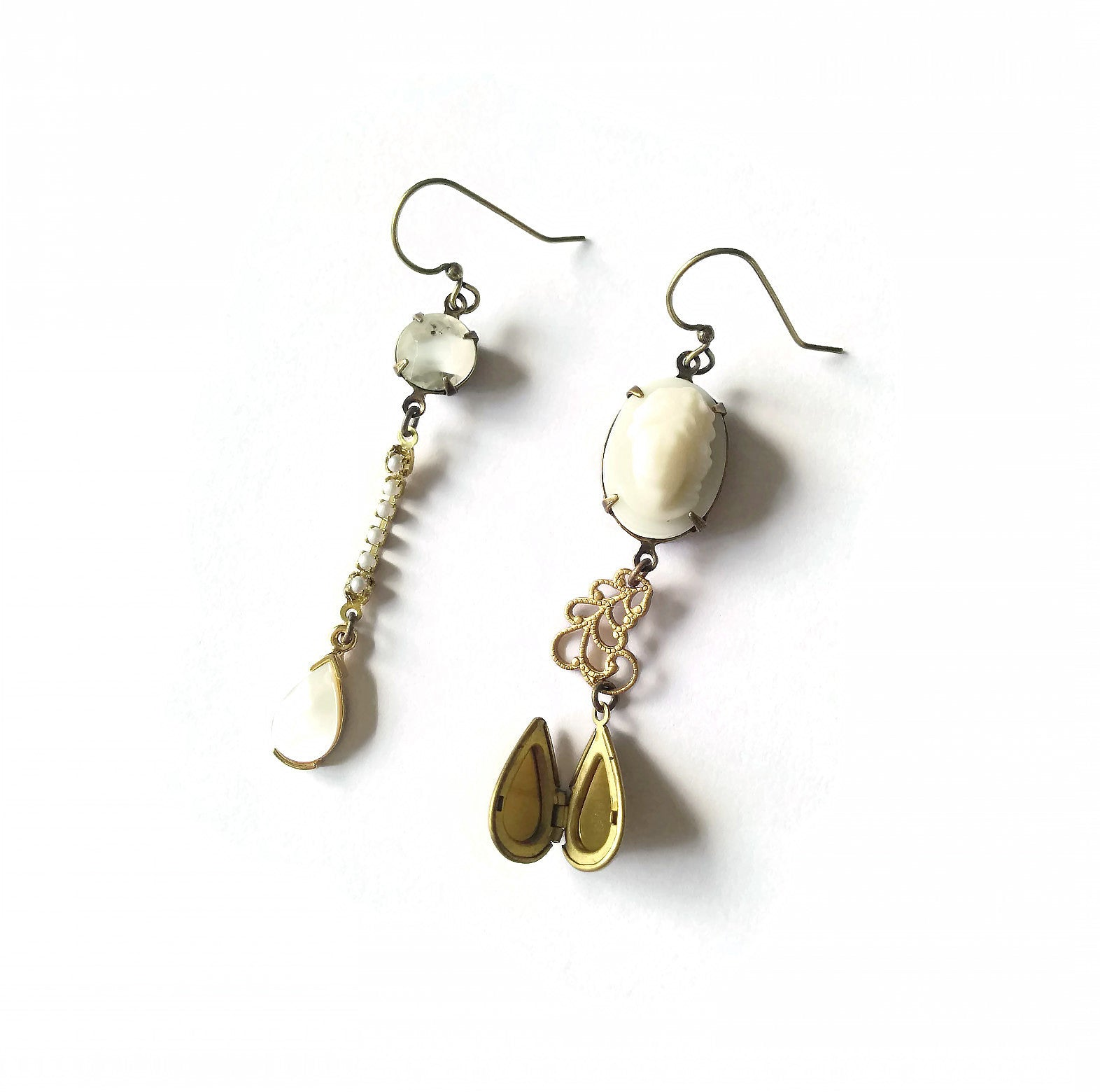 Mismatched earrings with cameo