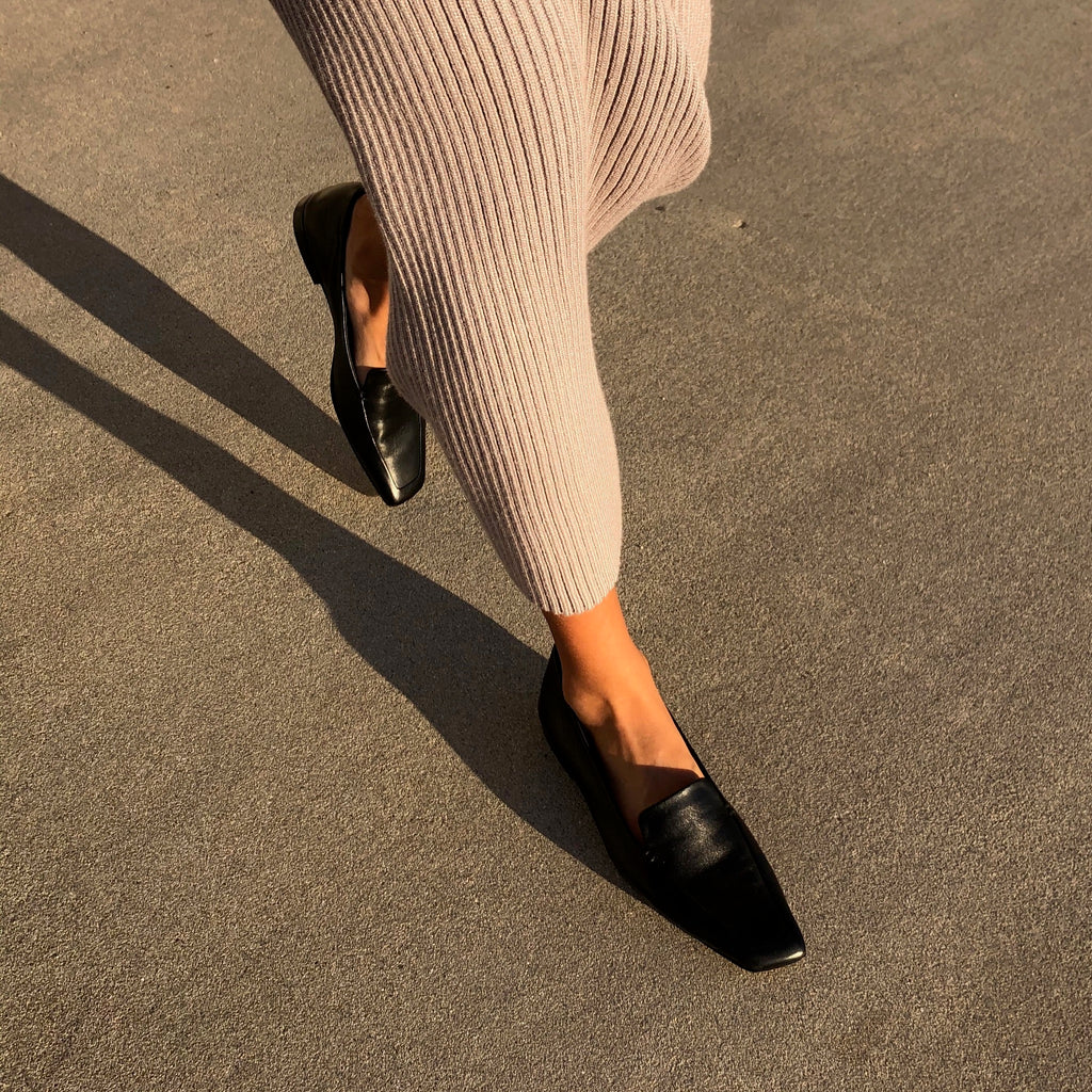 Neil J Rodgers black Liscia loafer with a pointed square toe and minimal stitching in soft Italian nappa leather paired with a blush ribbed sweater dress.