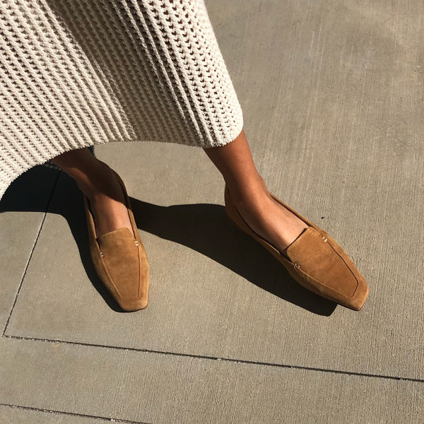 Neil J Rodgers camel suede Liscia loafer with a pointed square toe and minimal stitching in soft Italian nappa leather paired with an ivory crochet knit midi dress.