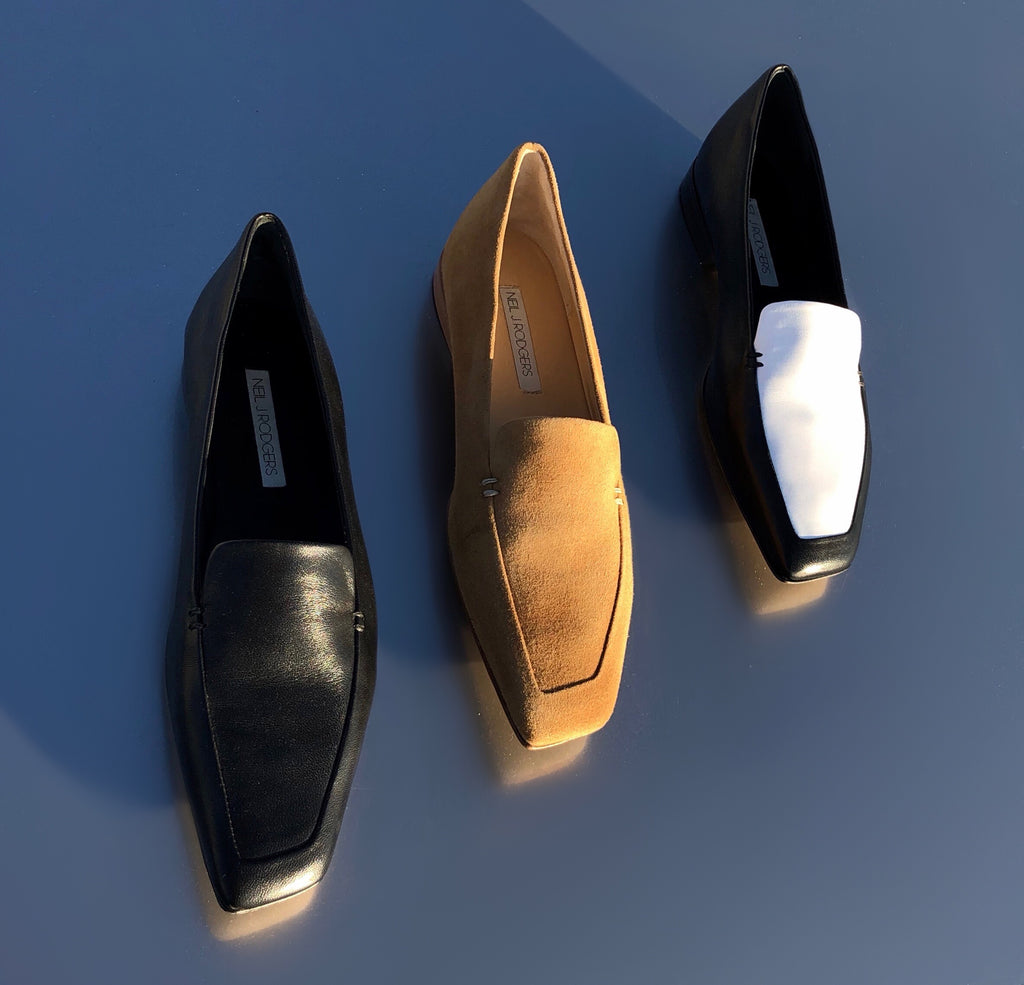 Neil J Rodgers Liscia loafer with a pointed square toe and minimal stitching available in black Italian nappa leather, camel suede, or two tone black and white nappa leather.