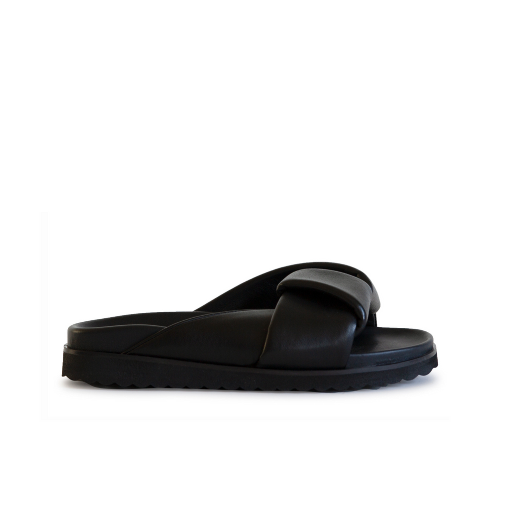 Neil J Rodgers black Obi slide sandal with padded leather straps, comfortable flat footbed and lightweight thick black sole.