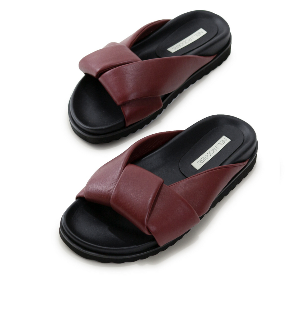Neil J Rodgers burgundy Obi slide sandal with padded leather straps, comfortable flat footbed and lightweight thick black sole.