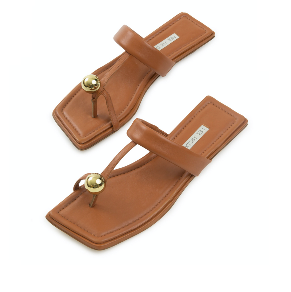 Neil J Rodgers camel Samira sandal with a flat footbed, minimal leather straps and gold bead embellishment