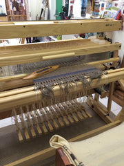 Weaving my weather inspired designs on my Louet Delta floor loom