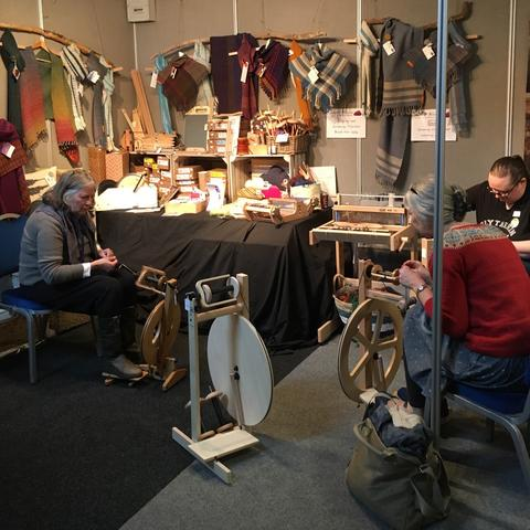 Spinners busy playing with wheels on our stand at EYF