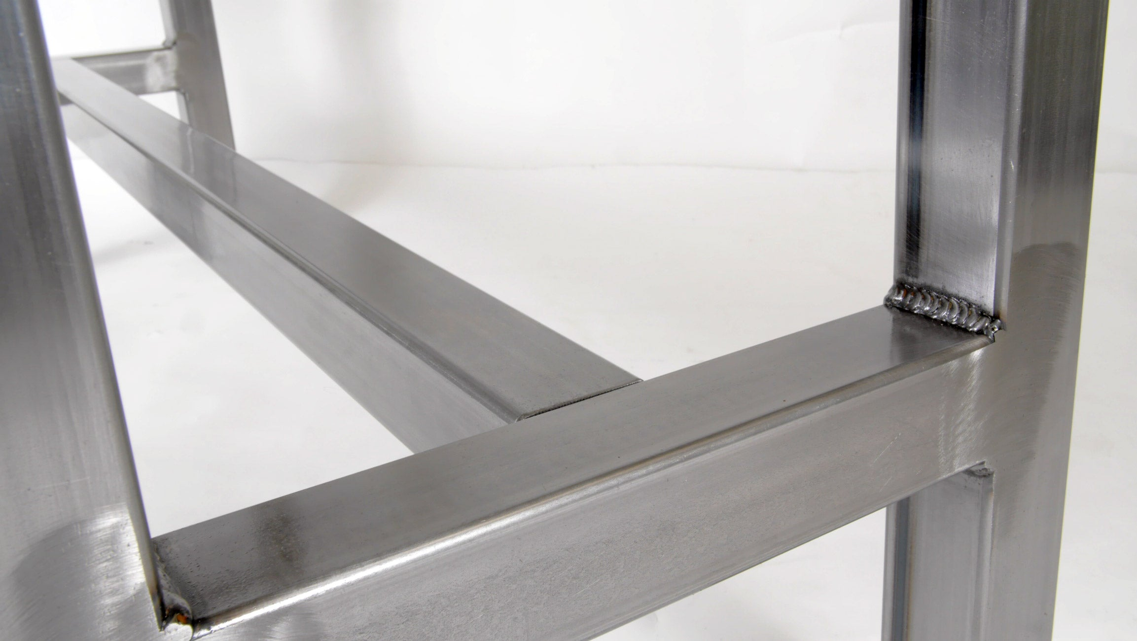 'Chassis' metal table base in clear sealant