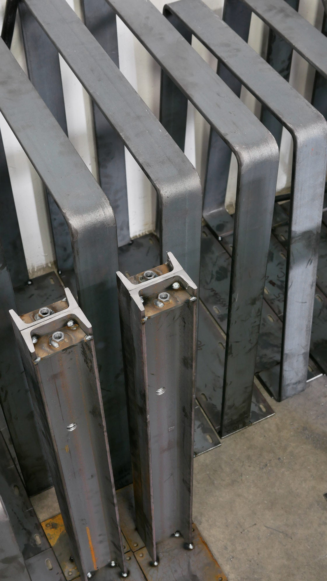 Unfinished metal table legs. Channel steel and flat bar steel shown here