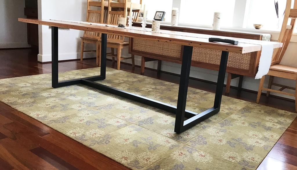 Metal table base in black powder coat - design = 'Gemini'