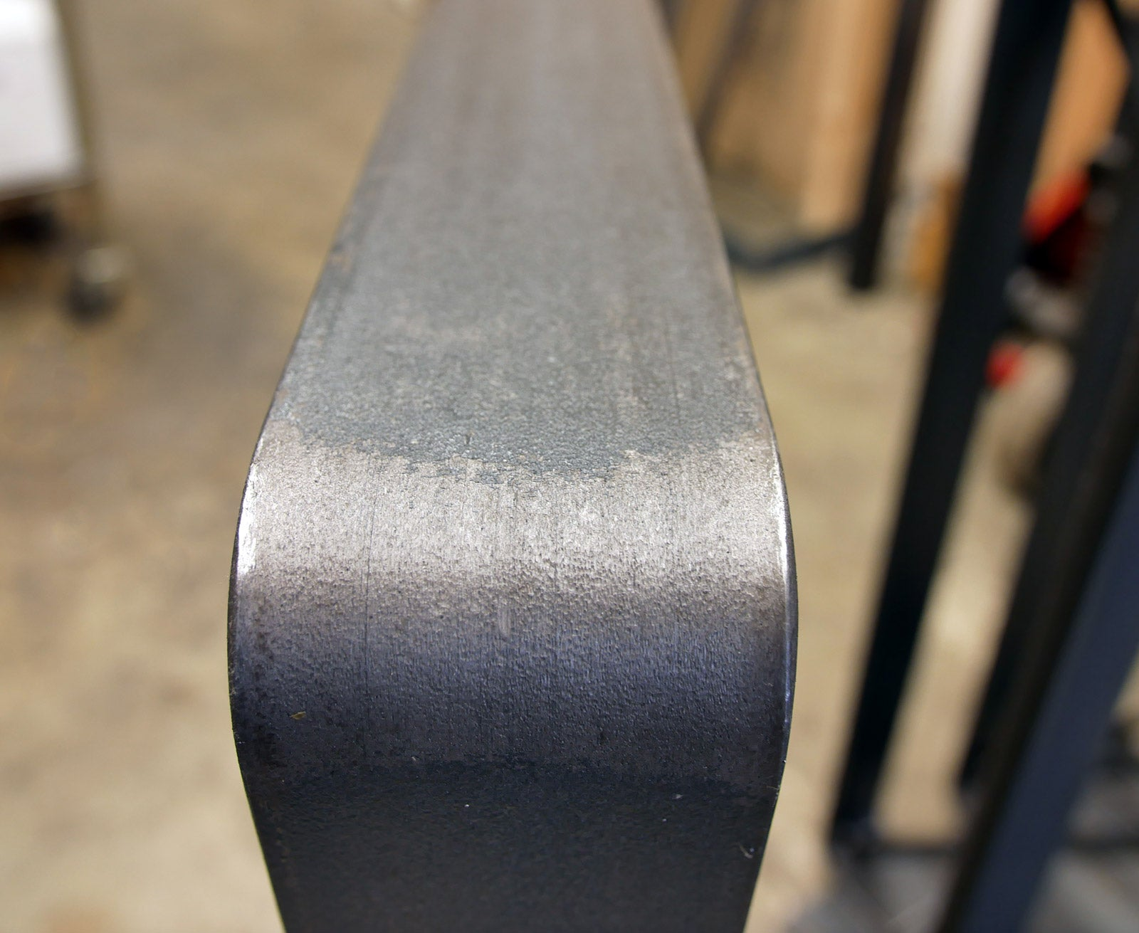 Outside corner of flat bar steel table leg