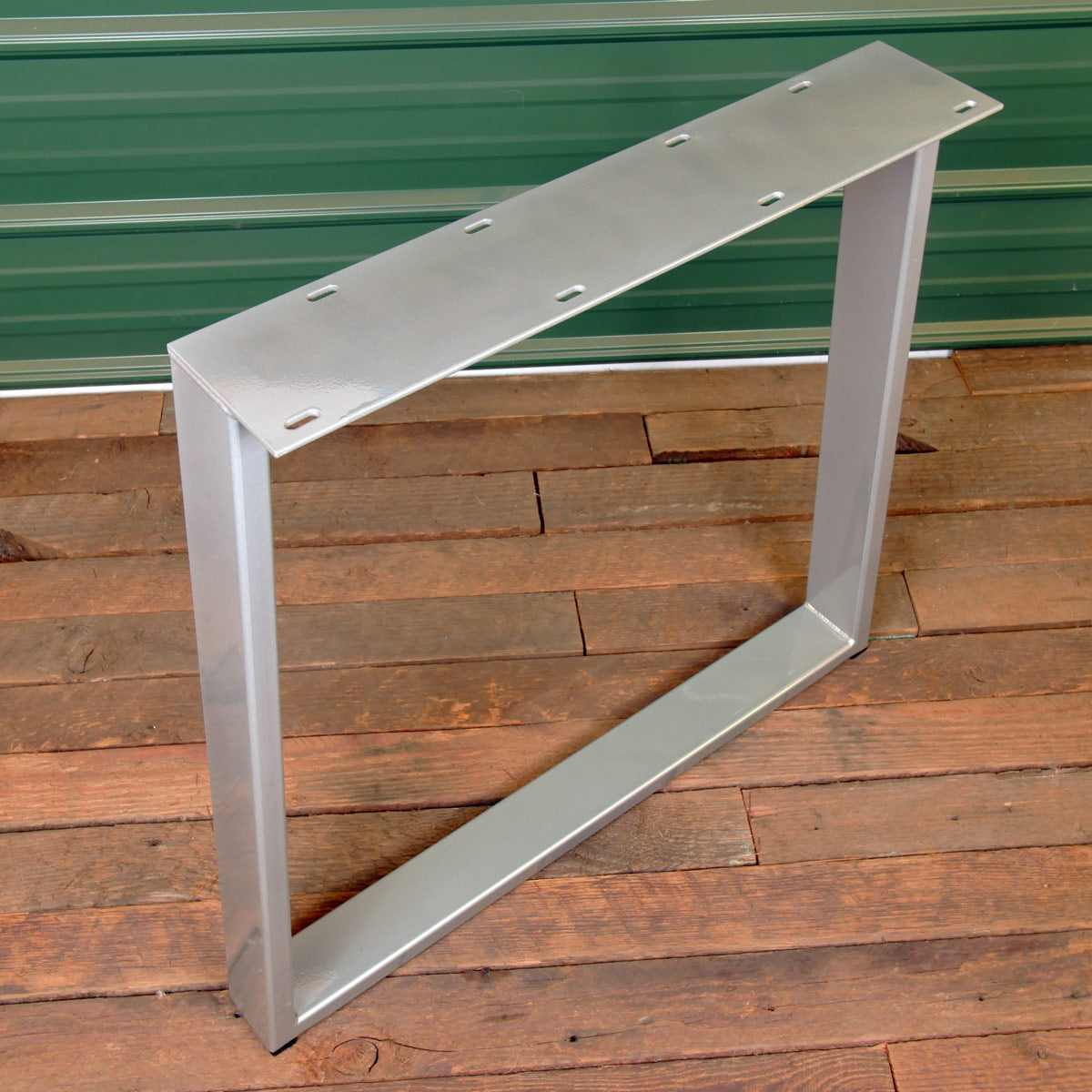 Metal dining table leg finished with silver powder coat