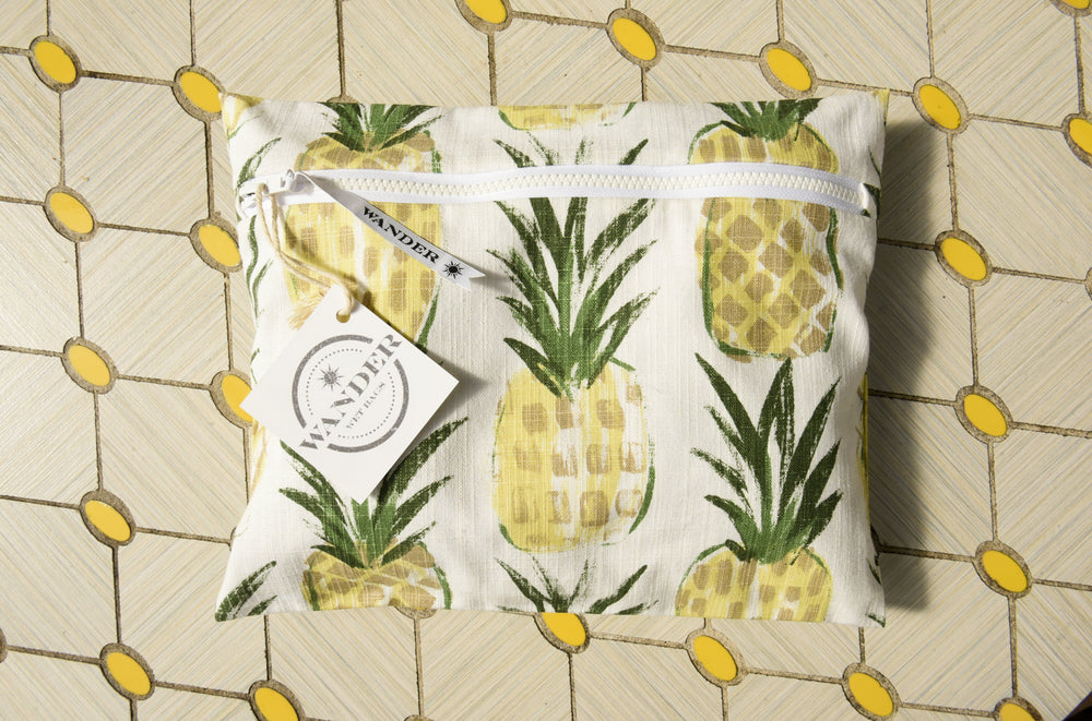 Wear a Crown in Pineapple Wet Bag , flat lay