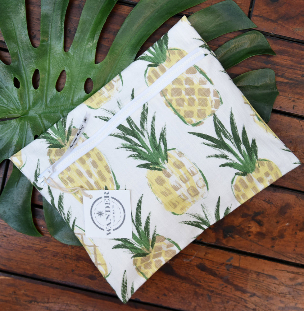 Wear a Crown in Pineapple Wet Bag , on wood background