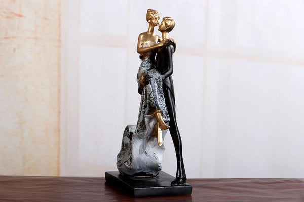 Wedding Cake Topper Figure -Groom Lifting Bride Gazing Lovingly Figurine)