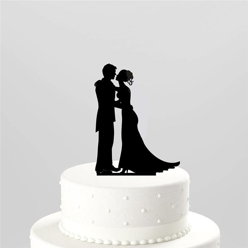 wedding cake toppers high five wedding cake topper groom embrace 26493