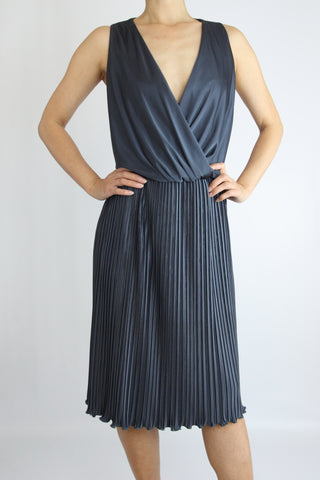 SURPLICE DRESS WITH PLEATED SKIRT