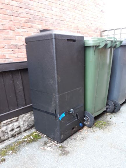 Black HotBin mini next to green wheelie bin