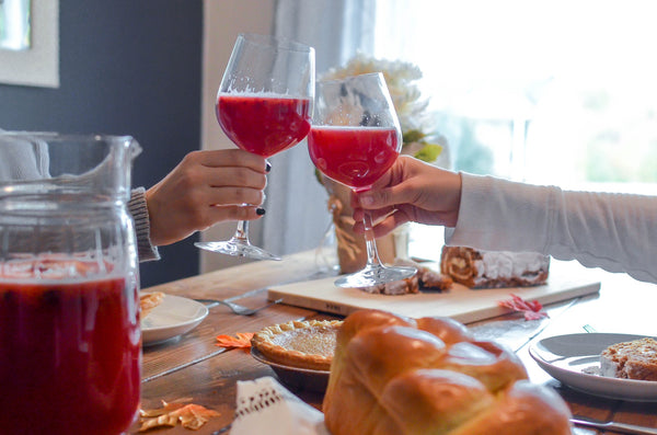 cheers with wine at a thanksgiving table