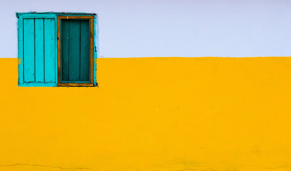 yellow wall with blue window